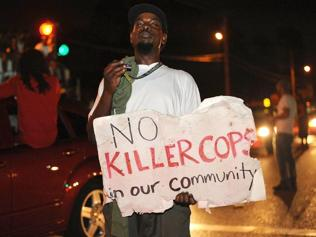 Ferguson shootings: video shows witness raising hands in air