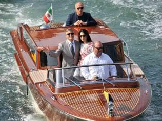 George Clooney leads a parade of boats for his wedding