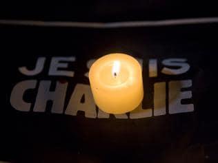 Charlie Hebdo plans 3 million run as France hunts for terror cell