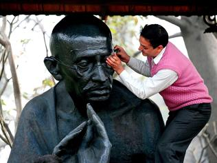Bachchan reading at Gandhi's statue unveiling in London