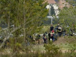 Tears and confusion as Hungary tries 'criminal' migrants