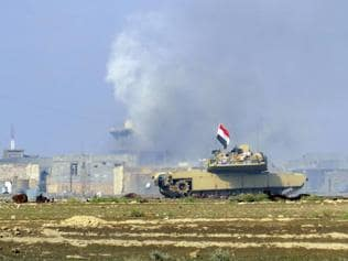Iraqi forces retake key bridge, cut last IS supply line to Ramadi