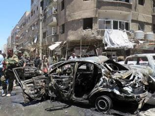 Islamic State claims blasts near Damascus Shia shrine that killed 20