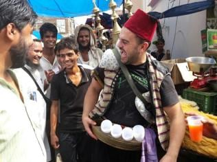 Serving cold sherbet to people, a Syrian walks the streets of Gurgaon