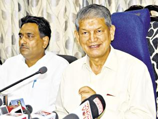 Rawat hopes 'elder brother' Modi will release funds for state