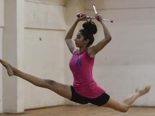 Young gymnasts practice hard, but don't have it easy