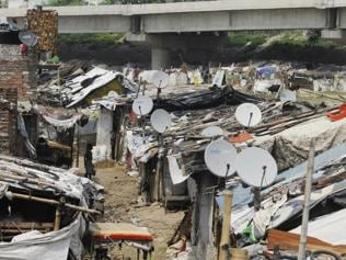 In Lucknow slums, TVs 'dish' out smiles on faces of the underprivileged