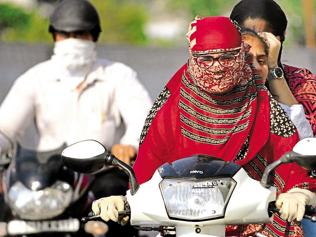 People riding two-wheelers with covered faces to face police action in Patiala