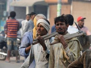 Wages unpaid, Delhi's migrant workers mull leaving the city