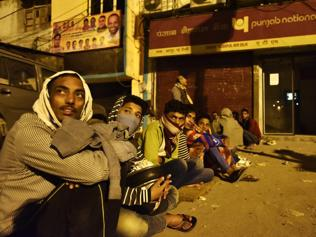Out in the cold at night: Cash rush brings life to a halt outside Delhi banks