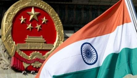 A file photo of an Indian flag next to the Chinese national emblem during a welcome ceremony for visiting Indian officials outside the Great Hall of the People in Beijing. India and China have been engaged in a month-long border standoff in the Doklam region located in the tri-junction of India, China and Bhutan.