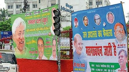 The posters put up by the warring factions of JD(U) at the Income-Tax roundabout in Patna on Friday.