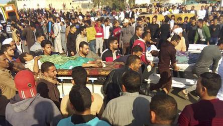 Injured people being evacuated from the scene of a militant attack on a mosque in Bir al-Abd in the northern Sinai Peninsula of Egypt on November 24, 2017.