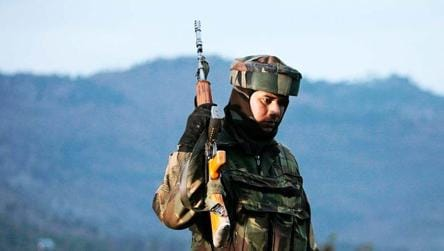 File photo of an Indian Army soldier as he patrols near the Line of Control.