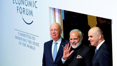 Prime Minister Narendra Modi with Klaus Schwab, Founder and Executive Chairman of World Economic Forum, and Swiss President Alain Berset as they arrive at the Opening Plenary during the World Economic Forum (WEF) annual meeting in Davos, Switzerland.