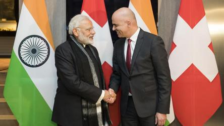 Swiss Federal President Alain Berset, right, and Indian Prime Minister Narendra Modi, shake hands prior to a meeting one day before the start of the 48th annual meeting of the World Economic Forum, WEF, in Davos on Monday.