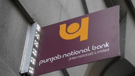 The logo of Punjab National Bank is seen outside of a branch of the bank in the City of London financial district in London.