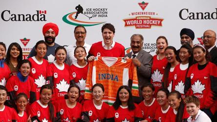 Canadian Prime Minister Justin Trudeau (centre) poses for a picture with India's Women Ice Hockey Team players during an event in New Delhi on Saturday.