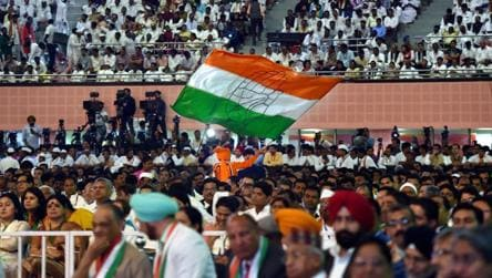 A Congress worker waves a flag during the 84th Plenary Session of The Indian National Congress (INC) at the Indira Gandhi Stadium in New Delhi on Saturday.