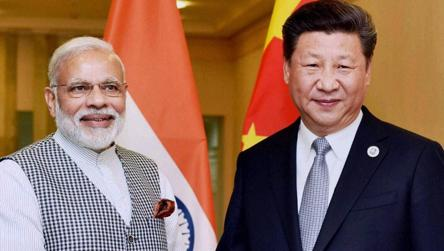 Prime Minister Narendra Modi with Chinese President Xi Jinping during a meeting in Tashkent on the sidelines of a summit.