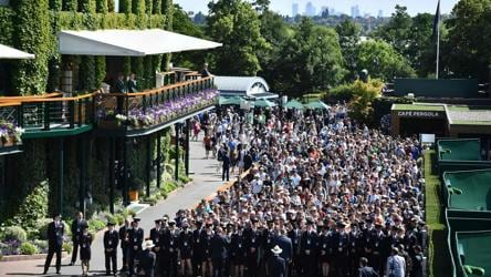 Spectators queue, in true British style, to enter The All England Tennis Club in Wimbledon on the first day of the 2019 Wimbledon Championships. Only a limited number of tickets are available daily for Centre Court and courts No. 1 and No. 2, except for the last four nailbiting days when all are sold in advance.