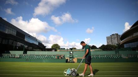 Groundstaff prepare the court before play. Britain's summer burst of heat from across the continent ended being short-lived following a 34C Saturday in London. Cool air from Greenland is said to have plummeted temperatures to highs of 22C and cloudy skies just in time for the first serve.