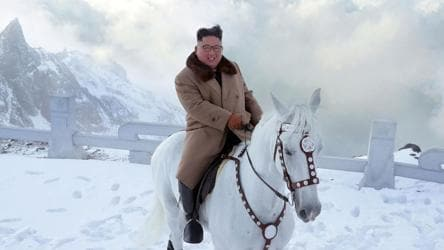 Kim rides horse on sacred peak, vows to fight US sanctions