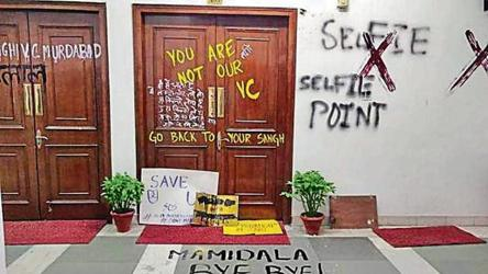 JNU announces roll back of fee hike, students vow to continue protest