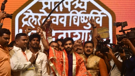 Raj Thackeray unveils new saffron MNS flag, son Amit joins party