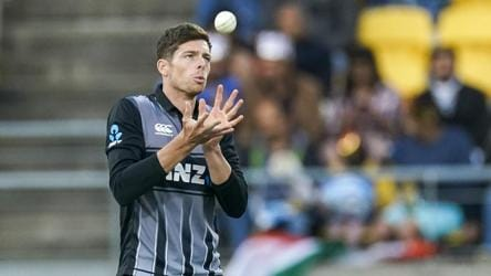 New Zealand's Mitchell Santner catches the ball.