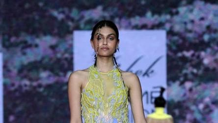 A model walks the ramp showcasing the creation of fashion designer Swapnil Shinde on Day 2.