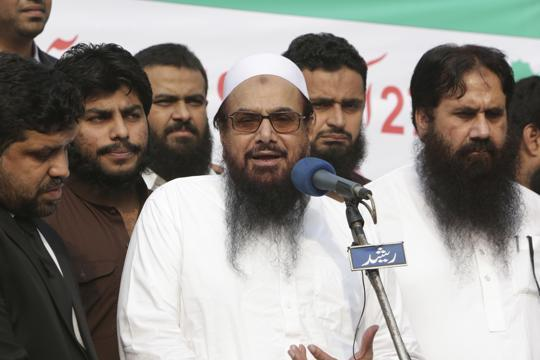 Pak bans Hafiz Saeed's JuD; Imran Khan puts army on standby to 'respond' to India