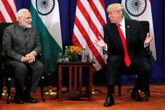 Ahead of meeting with PM Modi, Trump says India must withdraw tariffs