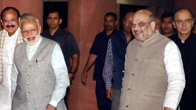 PM Narendra Modi with BJP president Amit Shah after the NDA meeting at Parliament house in New Delhi.(PTI File Photo)