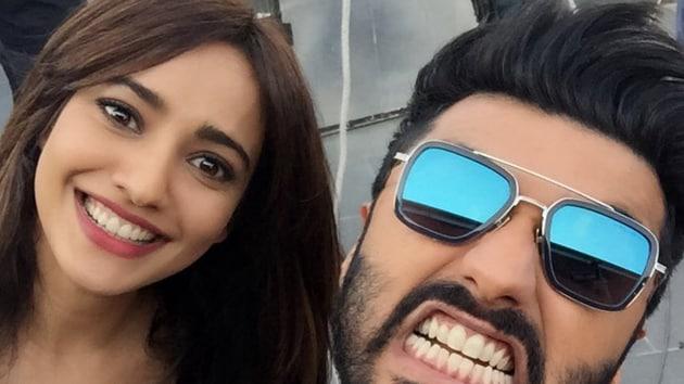 Arjun Kapoor and Neha Sharma on sets of Mubarakan.(Twitter)