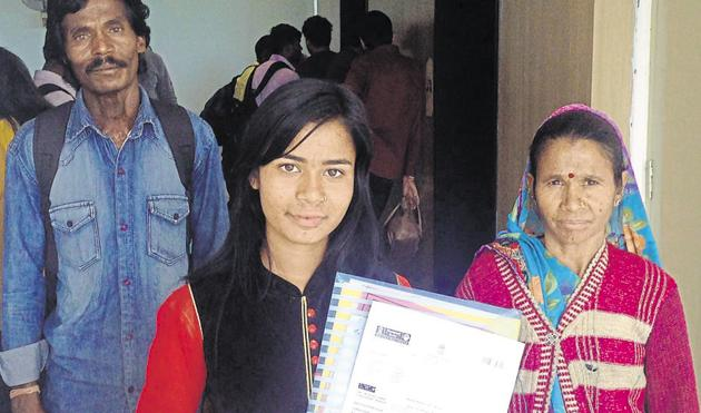Asha Gond with her parents at the passport office in Bhopal.(HT photo)