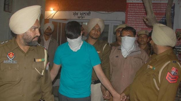 Mohali police officials with the fake currency accused during the press conference at police station Sohana in Mohali on Wednesday(Ravi Kumar/Hindustan Times)