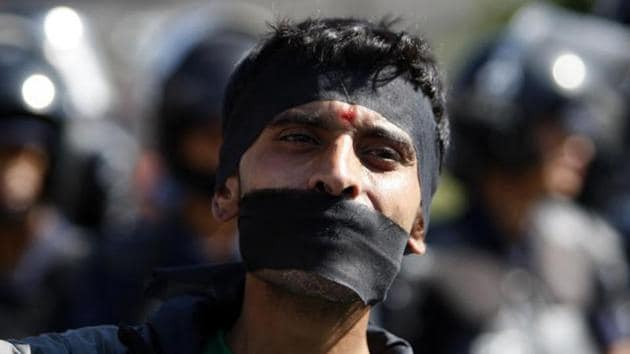 A Nepalese activist with his mouth covered gathers with others from the Federal Alliance (members of the Madhesi and ethnic communities) to voice their anti-constitution concerns on the first anniversary of Nepal's constitution in Kathmandu on September 19.(AFP File)