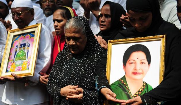 Indian Muslims hold a portrait of Tamil Nadu CM Jayalalitha Jayaram as they pray for her well being in front of a hospital.(ARUN SANKAR/AFP file photo)