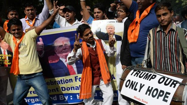 Right-wing activists of India's Hindu Sena celebrate the victorious outcome for US Republican presidential candidate Donald Trump in the US presidential elections in New Delhi on November 9.(AFP file photo)