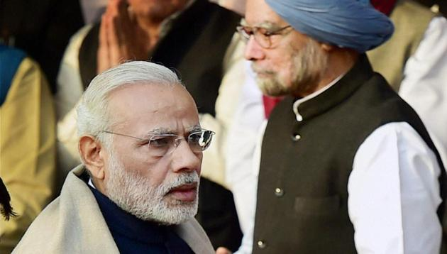 Prime Minister Narendra Modi with former PM Manmohan Singh on the occasion of Bhimrao Ambedkar's 'Mahaparinirvan Diwas' at Parliament House Lawns, in New Delhi on Tuesday.(PTI)