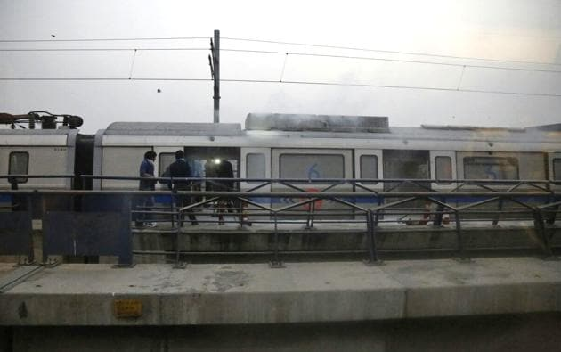 A Metro coach that caught fire at Patel Nagar Metro station on Thursday evening. It was the last bogey of the six-coach train that was headed to Vaishali on the Blue Line.(Sanchit Khanna/HT Photo)