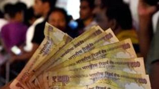 Since the demonetisation announcement on November 8, people across the country have struggled to withdraw cash from banks and ATMs. Many with the banned banknotes have failed to exchange them for new ones.(PTI)
