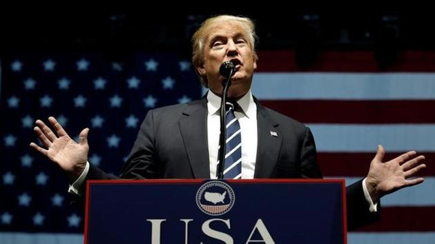 """US President-elect Donald Trump speaks at a """"Thank You USA"""" tour rally in Grand Rapids, Michigan on December 9.(Reuters)"""
