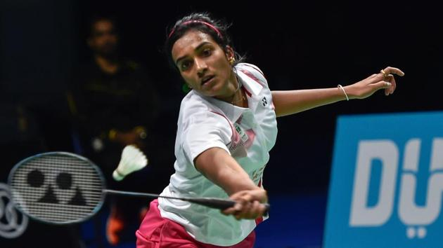 PV Sindhu of India plays a shot against China's Sun Yu during their women's singles badminton match during the World Superseries Finals.(AFP)