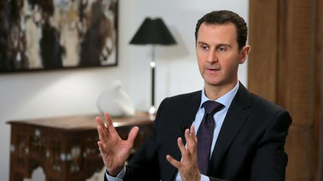 Syrian president Bashar al-Assad speaks during an interview with AFP in the capital Damascus in February 2016.(AFP)
