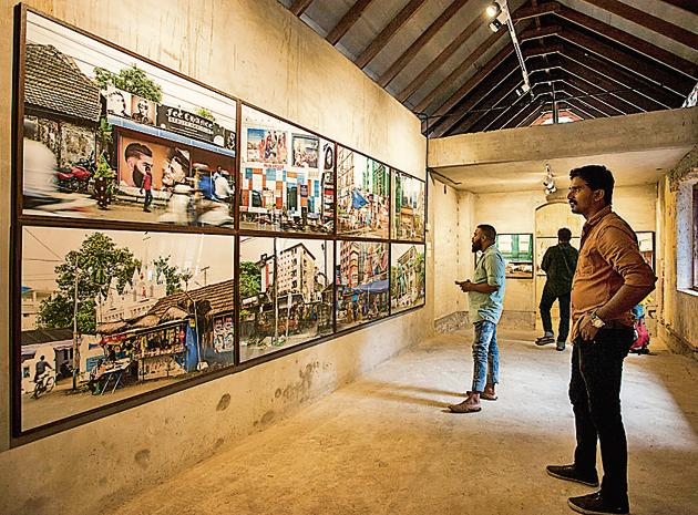 Visitors at an exhibition of works by artists from the Pepper House art residency programme.