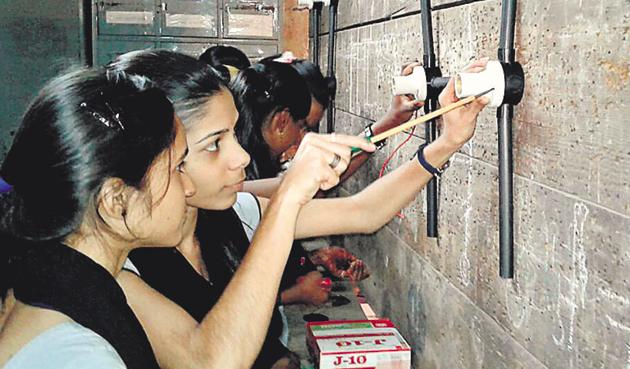 Young women training to be electricians test their skills at the government-run Industrial Training Institute for Girls in Thane.(Image courtesy UNDP)