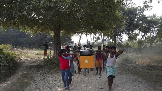 Relatives and villagers carry the coffin of Balkisun Mandal Khatwe at Belhi village, Saptari district of Nepal in November. Balkisun, who had been working in Qatar for less than a month, died in his sleep.(AP photo)