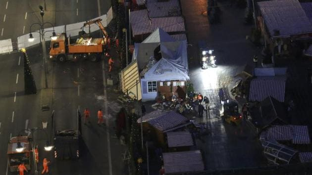 Workers clear the site of the Christmas market in Berlin, Germany, after a truck ploughed through a crowd at the Christmas market.(Reuters Photo)